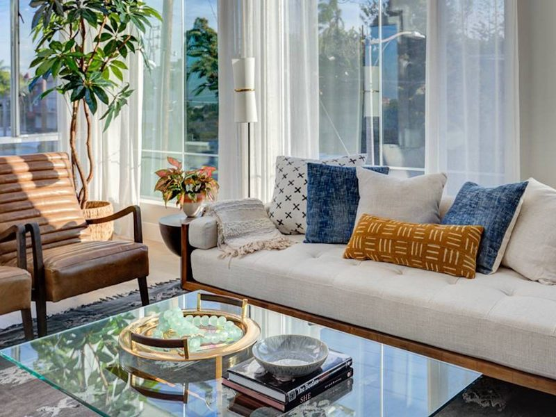 Living room redesign. Leather ribbed chairs. White sofa, glass coffee table. Redondo Beach.