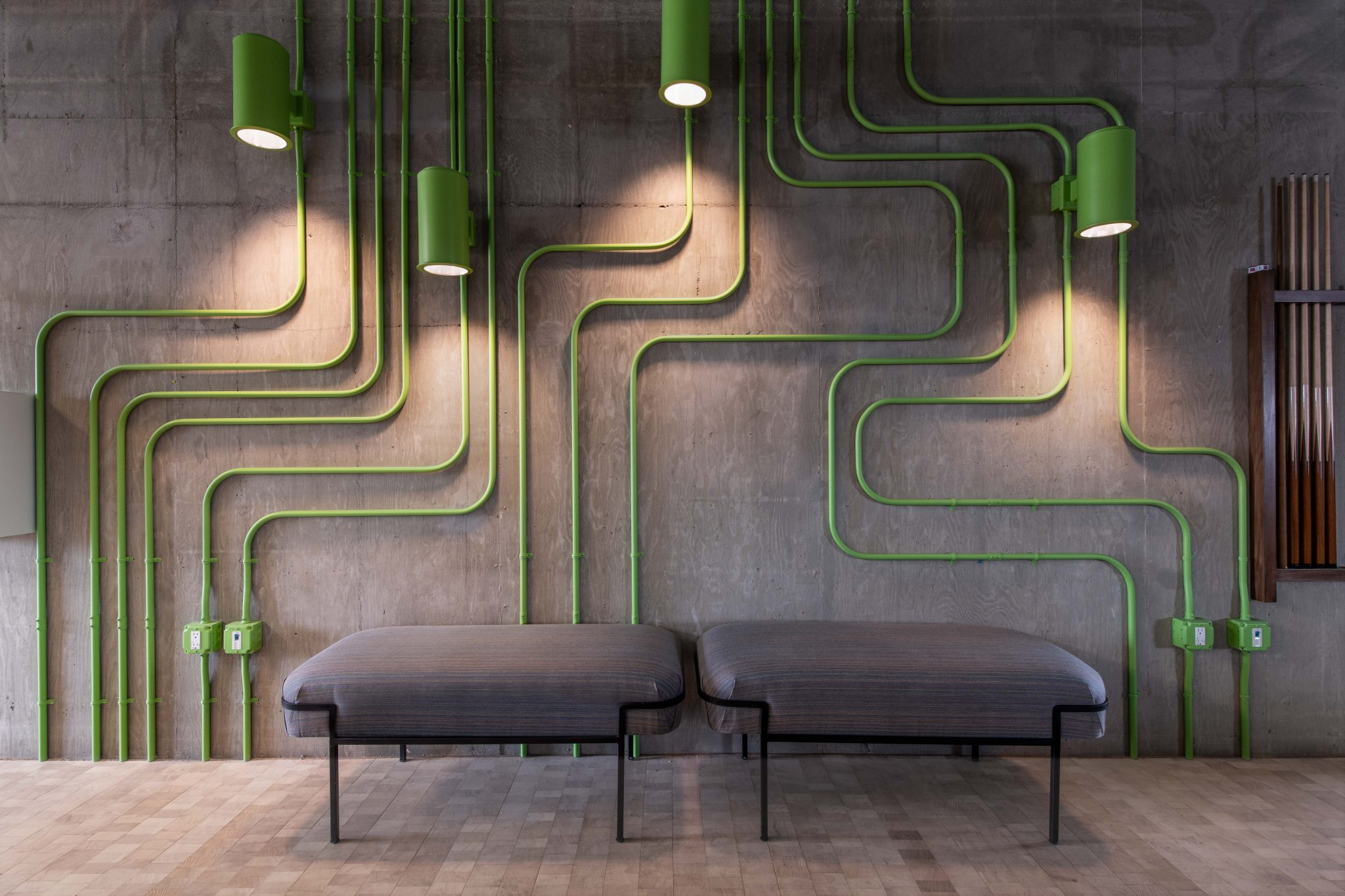 Lighting revamp, green non linear lamp structures. Downtown LA shared workspace, DDI Designs
